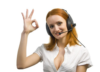 Beautiful smiling business woman with headset shows OK sign