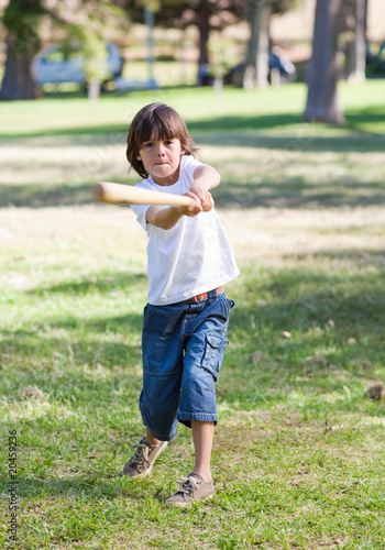 Lively little boy playing baseball