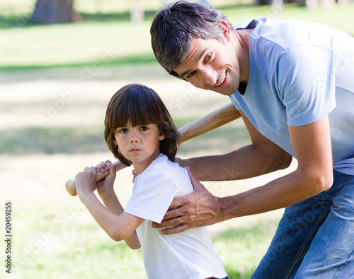 Portrait of a father teaching baseball to his son