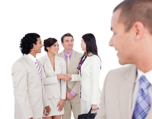 Positive business co-workers shaking hands
