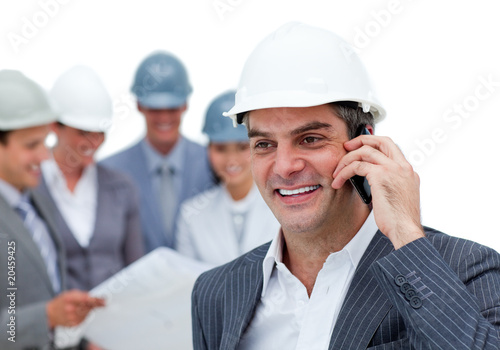 Mature male architect on phone standing