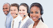 Smiling business team with headset on