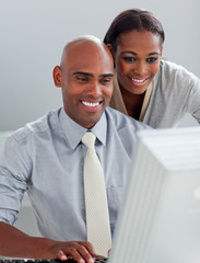 Confident business partners working at a computer together