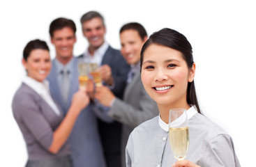 Asian businesswoman and her team celebrating a success