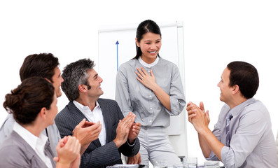 Victorious businesswoman applauded for her presentation