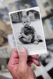 Fototapety childhood: man holding photo of himself as a boy