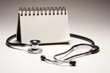 Blank Spiral Note Pad and Black Stethoscope