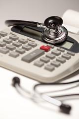 Black Stethoscope on Calculator
