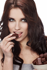 girl in act to eat a chocolate