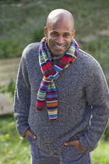 Portrait of smiling man wearing scarf