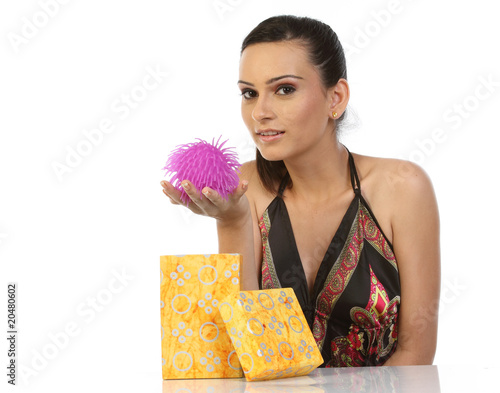 Woman feeling happy seeing her gift from the gift box