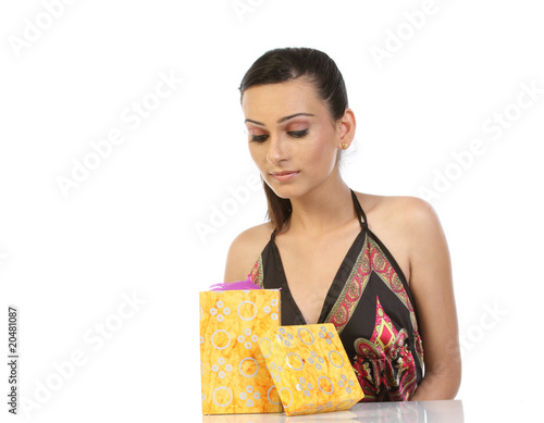 Teenage girl with the gift box