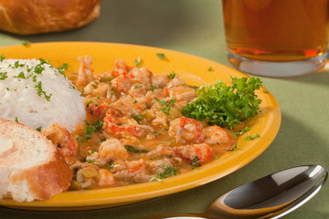 Plate of delicious thick cajun crawfish etouffee with rice