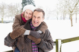 Fototapety Senior Couple Standing Outside In Snowy Landscape