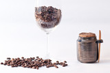 cup with coffee beans and sugar