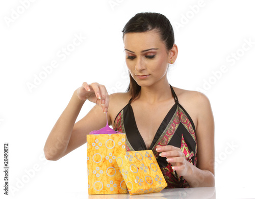 young woman taking the gift from the gift box