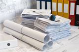 Heap of design and project drawings in yellow folder. - 20495487