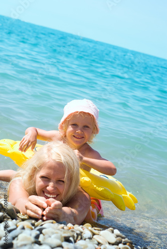 Mother and daughter swimming in the sea