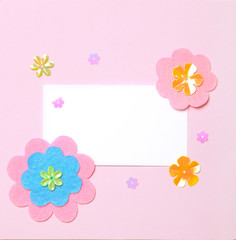 White blank card on pink paper background