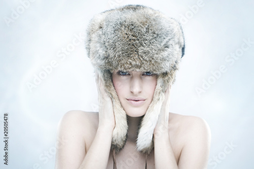 beautiful girl in a fur hat