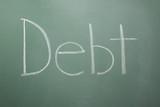 Debt written on chalkboard poster