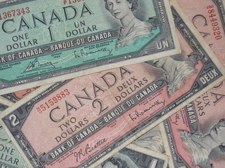 Old Canadian 1 and 2 Dollar Bank Notes Pile