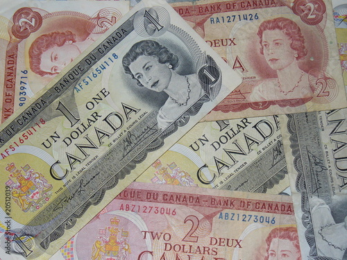 Canadian 1 and 2 Dollar Bills Pile