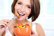 cheerful female eats vegetable salad