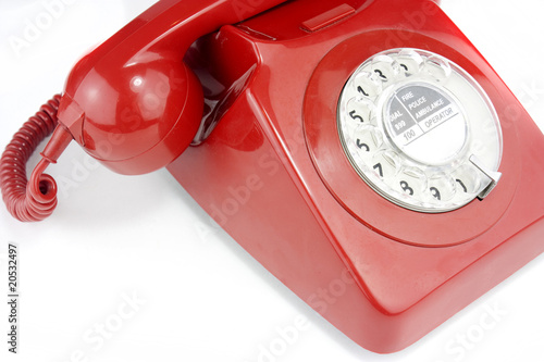 old fashioned bright red telephone handset