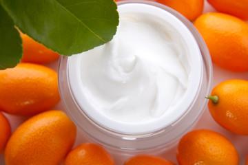 Face cream and fresh cumquats