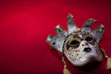 ornate carnival mask over red background