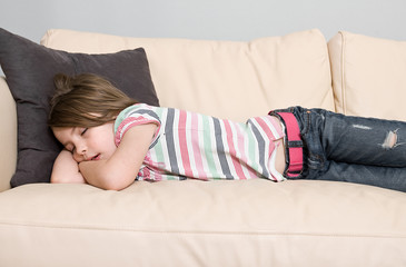 Young Child Asleep on a Leather Sofa