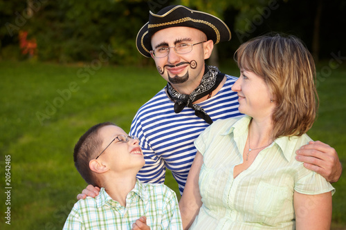man in pirate suit with wife and son in fall evening park