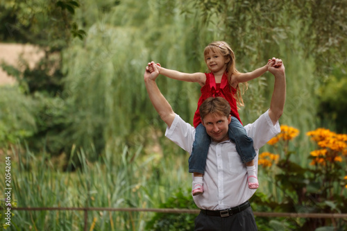 Portrait of man with daughter in summer garden