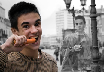 Same man, on one side eating carrot and other smoking cigarette