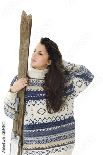 portrait of young woman holding old wooden ski