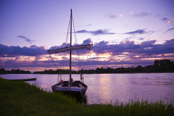 Fishing boat in Loire river at sunset. France