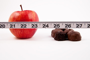 Red Apple, chocolate and a tape measure
