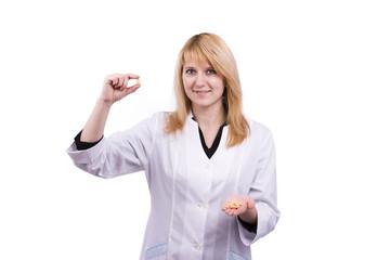 Caucasian doctor holding pills.