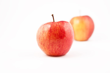 Two red Apples, one in focus