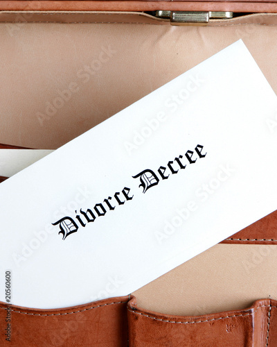 Divorce documents in a leather briefcase - vertical