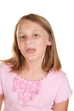 young girl poking out tongue poster
