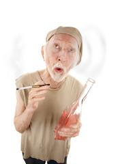 Senior man with gigarette and liquor bottle