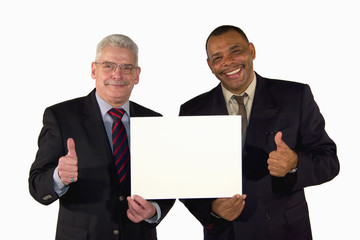 interracial business team holding board and posing thumbs up