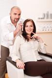 Professional hairdresser choose hair dye color at salon poster