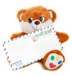teddy bear holding envelope isolated on white background