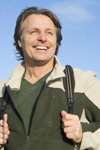 happy smiling outdoor man carrying rucksack