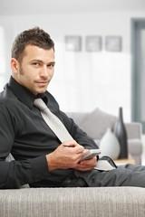 Businessman using palmtop