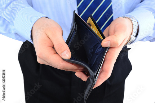 Businessman well-dressed with empry wallet isolated over white