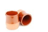 Vibrant orange ceramic planting pots on white poster